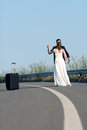 Bride and groom dancing in the middle of the road Stock Image