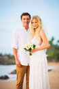 Bride and groom enjoying amazing sunset on a beautiful tropical beach romantic married couple Royalty Free Stock Photography