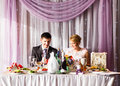 Bride And Groom Enjoying Meal At Wedding Reception Royalty Free Stock Photo