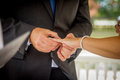 Bride and groom exchanging vows and rings just married couple Stock Photos