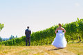 Bride and groom first look a men women share a moment as outdoors at a winery vineyard in oregon Royalty Free Stock Photography