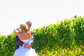 Bride and groom first look a men women share a moment as outdoors at a winery vineyard in oregon Royalty Free Stock Photo