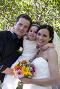 Bride and Groom with Flower Girl Stock Images