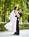 Bride and groom with flower outdoor in park summer Stock Photography
