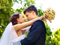Bride and groom with flower outdoor summer Royalty Free Stock Images
