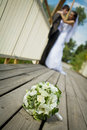 Bride and groom with flowers in front Royalty Free Stock Photography
