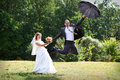 Bride and groom flying on umbrella Stock Image