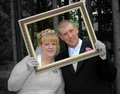 Bride and Groom Formal Portrait in Frame Selective Color Stock Photography
