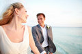 Bride and groom getting married in beach ceremony smiling to each other Stock Photos