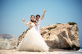 Bride and groom with glasses of champagne on the beach Mediterranean Sea Royalty Free Stock Photo