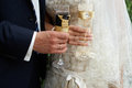 Bride and groom with glasses of champagne wedding in hands the wedding rings Stock Images