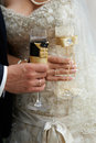 Bride and groom with glasses of champagne wedding in hands the wedding rings Royalty Free Stock Image