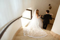 Bride and groom go downstairs through a fortress entrance Royalty Free Stock Photo