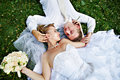 Bride and groom on grass Stock Photos