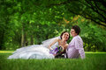Bride and groom on grass in park Royalty Free Stock Images