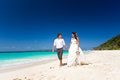 Bride and groom having fun on beach the tropical wedding Royalty Free Stock Image