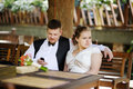 Bride and groom having fun at cafe outdoor Stock Photo