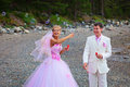 Bride and groom having fun with soap bubbles Royalty Free Stock Photo