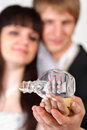 Bride and groom hold little vessel in bottle Stock Images