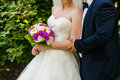 Bride and groom holding bridal bouquet close up Royalty Free Stock Photo