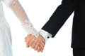 Bride and groom holding hands closeup of a over a white background horizontal format people are unrecognizable model released Royalty Free Stock Photography