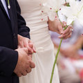 Bride and Groom holding their hands Stock Photo
