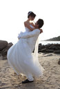 Bride and groom hug at sea side Royalty Free Stock Photography