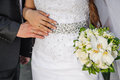 Bride and groom keep ring the bridal bouquet Royalty Free Stock Images