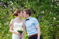 Bride and groom kiss in the spring garden Royalty Free Stock Photo