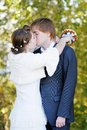 Bride and groom kissing Royalty Free Stock Image