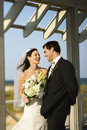 Bride and groom laughing. Royalty Free Stock Images