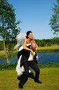 Bride and groom is lifting his up in a park Royalty Free Stock Image