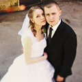 Bride and groom look tired hugging on the street Royalty Free Stock Photo