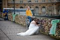 Bride and groom looking for their love padlock in a bridge over the seine river in paris france Royalty Free Stock Photos