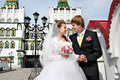 Bride and groom about the luxurious palace Royalty Free Stock Photography