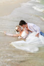 Bride groom lying beach shore Royalty Free Stock Photos