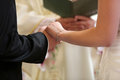 Bride and groom during the marriage oath holding hands together Royalty Free Stock Image