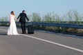 Bride and groom in the middle of motorway Stock Images