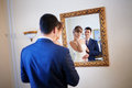 Bride and groom by the mirrir a Stock Photos