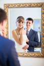 Bride and groom by the mirrir a Royalty Free Stock Photo