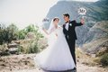 Bride and groom with mr and mrs signs just married beautiful young standing on the mountains background Stock Photography