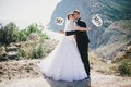 Bride and groom with mr and mrs signs just married beautiful young standing on the mountains background Royalty Free Stock Photos