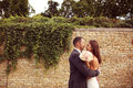 Bride and groom outdoors on their wedding day Royalty Free Stock Photo