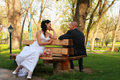 BRIDE AND GROOM IN A PARK Stock Images