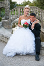 Bride and groom in a park near pool with a bridge outdoor married couple Royalty Free Stock Photos