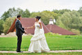 Bride and groom in a park outdoor portrait Stock Photo