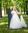 Bride and groom in park summer outdoor happy Royalty Free Stock Photography