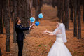 Bride and groom playing in the woods Stock Photo