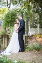 Bride and Groom  portrait in garden Royalty Free Stock Photo