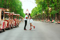 Bride and groom posing in amusement park Royalty Free Stock Photo
